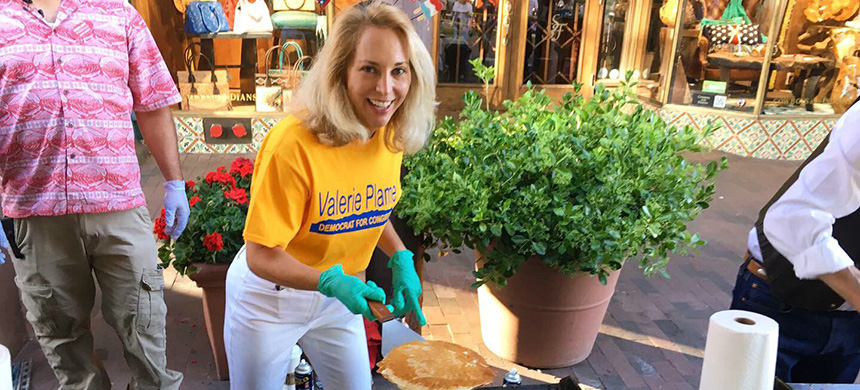 Democrat Valerie Plame - the former CIA operative running for Congress - campaigns by pitching in at Pancakes on the Plaza in Santa Fe on July 4. (photo: Valerie Plame campaign staff)