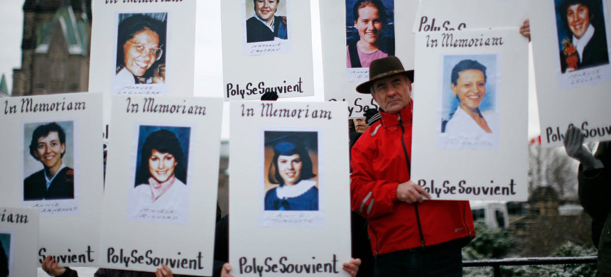 Demonstrators hold portraits of victims of the Montreal massacre during the national day of remembrance and Action on Violence Against Women rally on Parliament Hill in Ottawa 2011. (photo: Chris Wattie/Reuters)