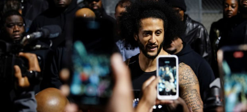 The attempt to drown out Kaepernick's voice has been going on since he first took a knee. (photo: Elijah Nouvelage/Reuters)