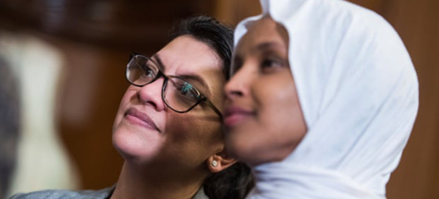 Coordinated Facebook posts made by an Israel-based group have vilified Muslim politicians such as Democratic congresswomen Ilhan Omar and Rashida Tlaib. (photo: Tom Williams/Getty)