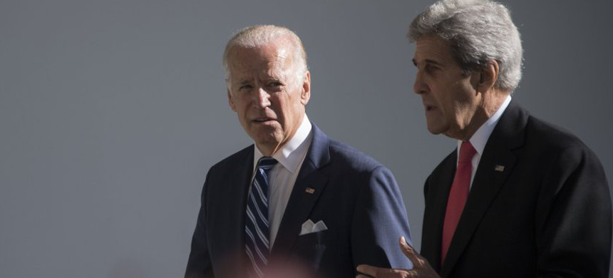 Joe Biden speaks with John Kerry as they walk the colonnade at the White House on Oct. 18, 2016. (photo: Getty)