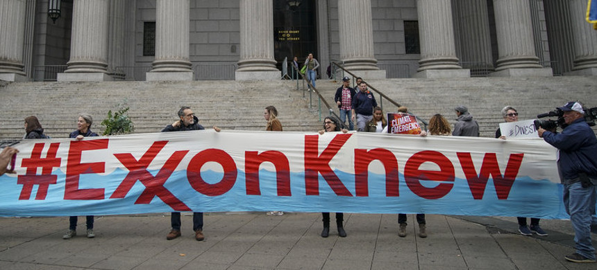 Environmental activists rally outside of New York Supreme Court in October in Manhattan, the first day of the trial accusing ExxonMobil of misleading shareholders about its climate change accounting. (photo: Drew Angerer/Getty)