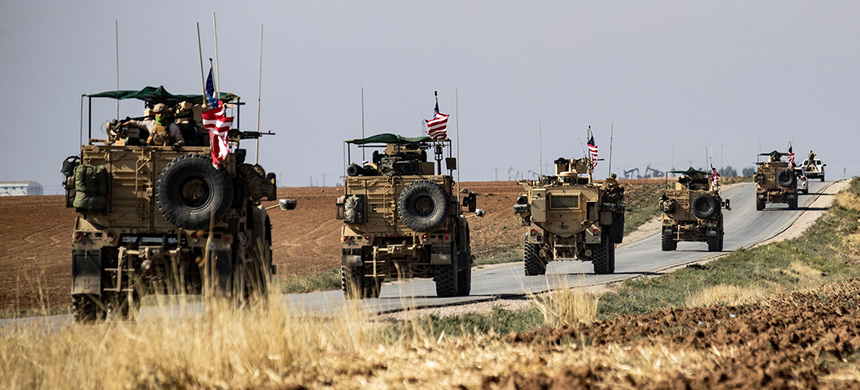 A convoy of U.S. armored vehicles patrols the northeastern town of Qahtaniyah, Syria, at the border with Turkey, on Oct. 31, 2019. (photo: Delil Souleiman/AFP/Getty Images)