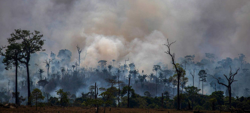Smokes rises from forest fires in Altamira, Pará state, Brazil, in the Amazon basin, August 27, 2019. (photo: Joao Laet/Getty)