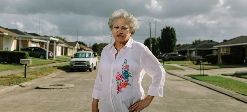 Marilyn Amar stands in front of her home in the Gordon Plaza neighborhood, where she has lived since 1990. (photo: William Wilmer/Guardian UK)