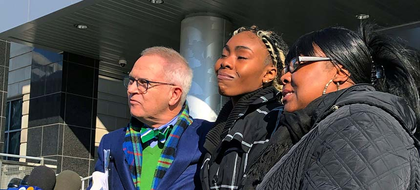 Jazmine Headley, center, had her toddler yanked from her arms by NYC police in a widely seen video said in an interview published on Sunday that she went into 'defense mode.' (photo: AP)