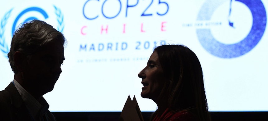 Chile's minister of environment and COP25 president Carolina Schmidt talks to Brazilian secretary for national sovereignty and citizenship Fabio Mendes Marzano during the closing session of the U.N. COP 25 climate conference in Madrid on Dec. 15. (photo: Oscar del Pozo/AFP/Getty Images)