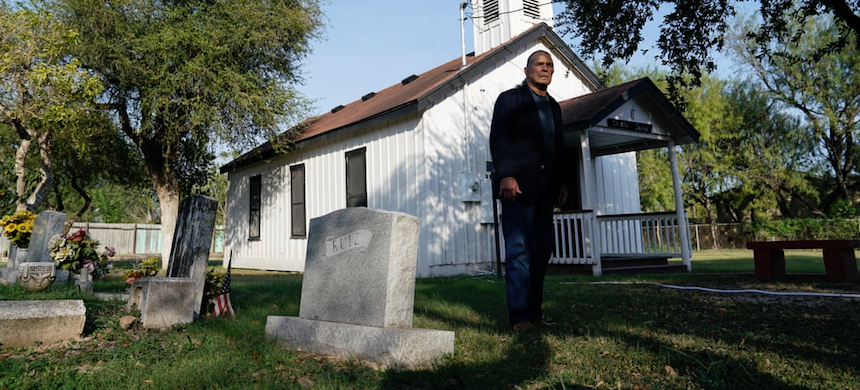 Ramiro Ramirez poses for a photo at the Jackson Ranch Chapel and Cemetery that could end up on the south side of Trump's border wall. (photo: Veronica G. Cardenas/Guardian UK)