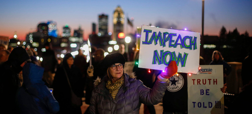 Jennifer Nellans of Des Moines holds a sign reading Impeach Now during an impeachment rally outside of the Iowa state capitol building in Des Moines, Iowa, on Tuesday, Dec. 17, 2019. (photo: Bryon Houlgrave/The Des Moines Register)