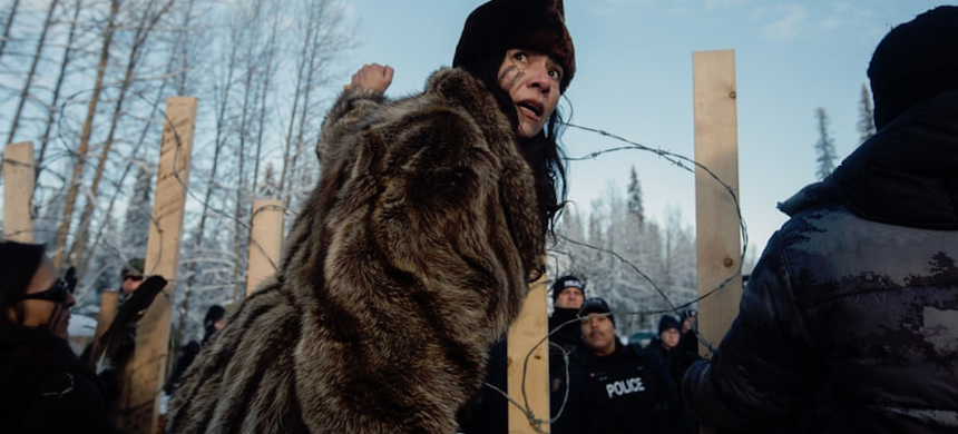 Sabina Dennis stands her ground as police dismantle the barricade to enforce the injunction filed by Coastal Gaslink pipeline at the Gidimt'en checkpoint near Houston, British Columbia, on 7 January. (photo: Amber Bracken)