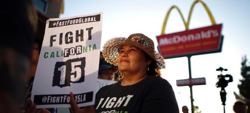 Demonstrators take part in a protest to demand higher wages for fast-food workers outside McDonald's in Los Angeles, California, May 15, 2014. (photo: AFP)