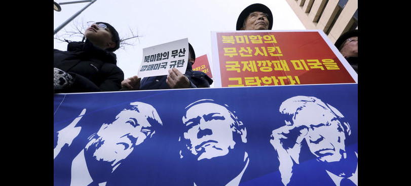 Protesters hold a banner showing images, of President Trump, Secretary of State Mike Pompeo, and National Security Adviser John Bolton during a rally against U.S. sanctions on North Korea, near the U.S. Embassy in Seoul, South Korea. (photo: Ahn Young-Joon/AP)