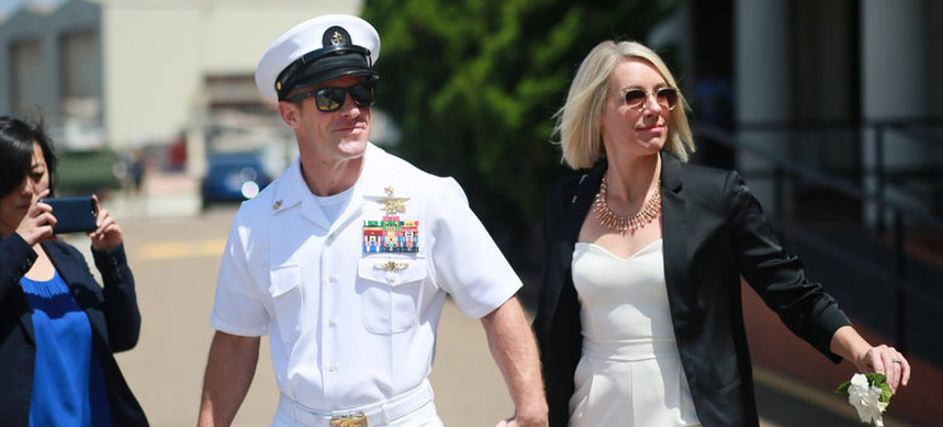 Navy Special Operations Chief Edward Gallagher walks out of military court with his wife Andrea Gallagher during lunch recess on July 2, 2019, in San Diego, California. (photo: Sandy Huffaker/Getty)