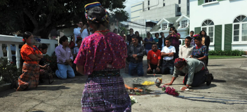 Family of victims of the Rio Negro massacres of the early 1980s in Guatemala take part in a Mayan ceremony outside the Inter-American Court of Human Rights in San Jose, Costa Rica, before a trial in 2012. (photo: Rodrigo Arangua/AFP/Getty Images)