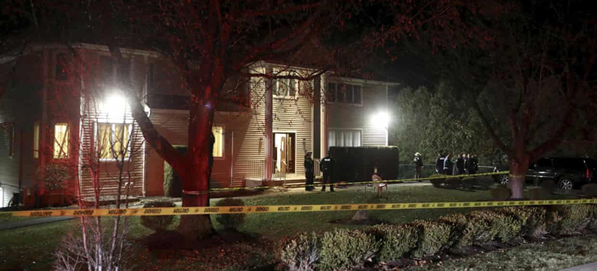 Police cordon at the house where the attack took place. (photo: Seth Harrison/AP)