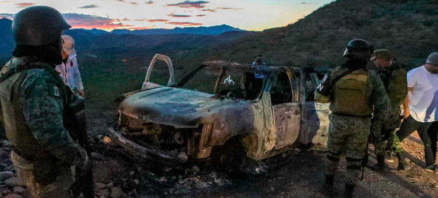 The burned wreckage of a car where some of the nine murdered members of a family were killed during an ambush in Bavispe, Sonora mountains, Mexico. (photo: AFP/Getty Images)