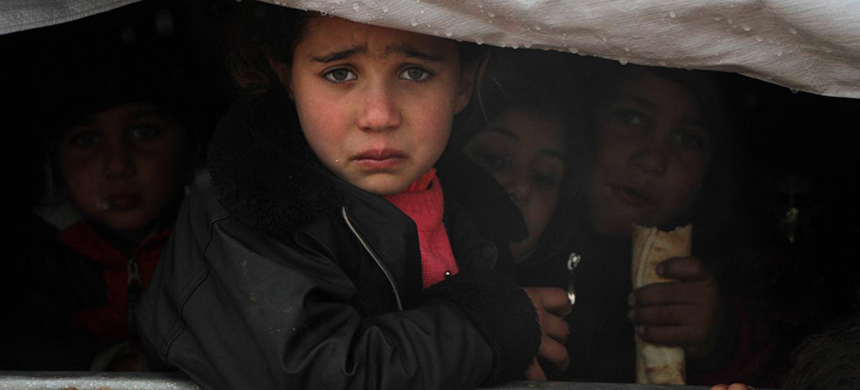 A Syrian child reacts upon her arrival in a truck at a camp for displaced people near the village of Harbnoush in the Idlib province on December 27, 2019. (photo: AFP)