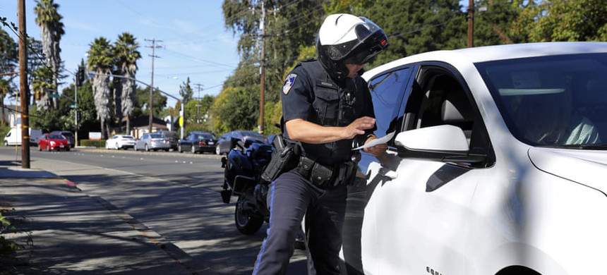 A police officer stops a driver in Santa Rosa, California, 10 October 2019. (photo: Christopher Chung/AP)