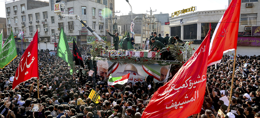 In this photo provided by The Iranian Students News Agency, flag draped coffins of Gen. Qassem Soleimani and others who were killed in Iraq in a U.S. drone strike are carried on a truck surrounded by mourners in the city of Ahvaz on Sunday. (photo: Alireza Mohammadi/AP)
