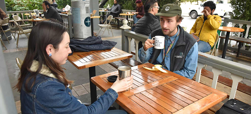 UC Berkeley students Mary Carmen Reid and Derek Popple enjoy coffee at Caffe Strada, a business that offers the Vessel program. (photo: Erin McCormick/The Guardian)