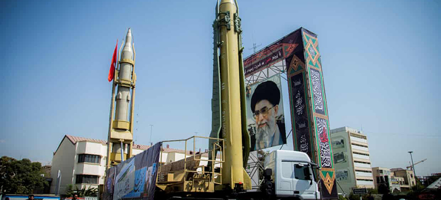 A display featuring missiles and a portrait of Iran's supreme leader, Ayatollah Ali Khamenei, is seen at Baharestan Square in Tehran, Iran, in 2017. (photo: Reuters)