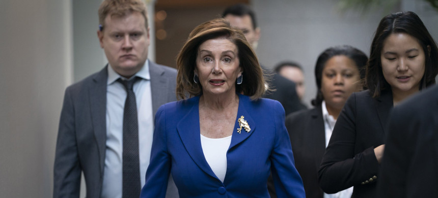 House Speaker Nancy Pelosi, D-Calif., arrives to meet with other House Democrats at the Capitol in Washington on Wednesday, Jan. 8, 2020. (photo: J. Scott Applewhite/AP)