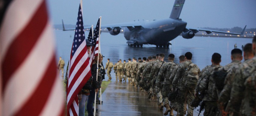 Paratroopers assemble at Ft. Bragg, N.C., on Saturday. (photo: Hubert Delany III/AP)