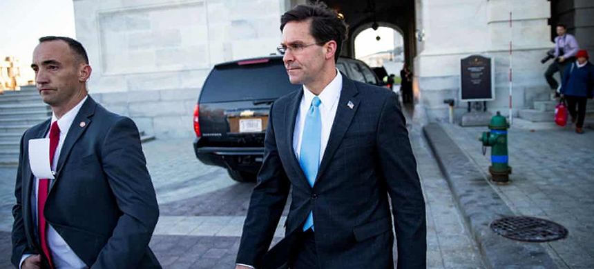 Defense secretary Mark Esper, right, departs after a briefing on developments with Iran at the Capitol on 8 January. (photo: Alexander Drago/Reuters)