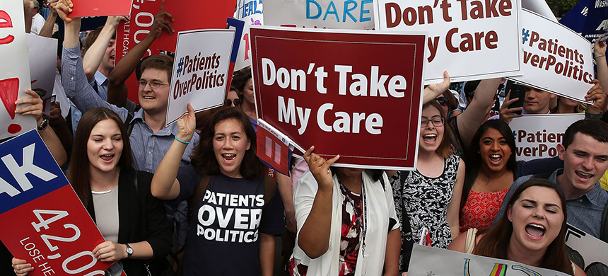 Affordable Care Act supporters gathered outside of the Supreme Court ahead of a 2015 ruling on the law's tax subsidies. (photo: Mark Wilson/Getty Images)