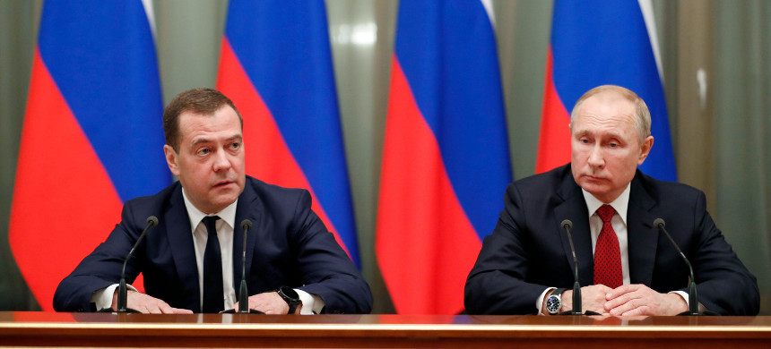Russian president Vladimir Putin, right, and Prime Minister Dmitry Medvedev meet with members of the government in Moscow on Jan. 15, 2020. (photo: Getty)