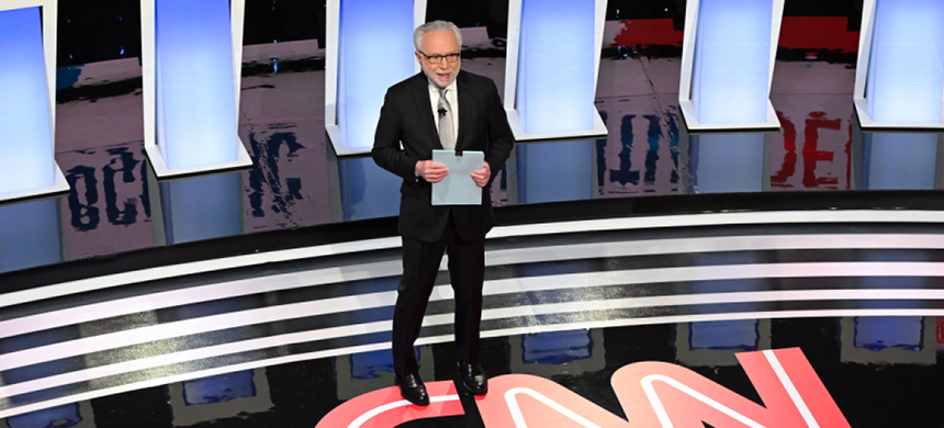 CNN journalist Wolf Blitzer arrives onstage to moderate the seventh Democratic primary debate of the 2020 presidential campaign season, co-hosted by CNN and the 'Des Moines Register' at Drake University, on January 14th, 2020. (photo: Robyn Beck/AFP/Getty Images)