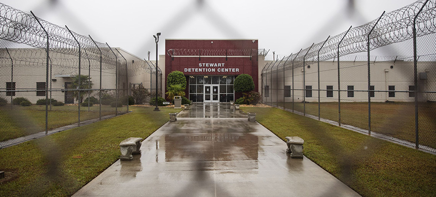 The Stewart Detention Center is seen through the front gate, Friday, Nov. 15, 2019, in Lumpkin, Ga. The rural town is about 140 miles southwest of Atlanta and next to the Georgia-Alabama state line. (photo: David Goldman/AP)