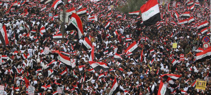 Hundreds of thousands of Iraqis, waving national flags, take to the streets in central Baghdad, January 24, 2020. (photo: Ahmad al-Rubaye/Getty)