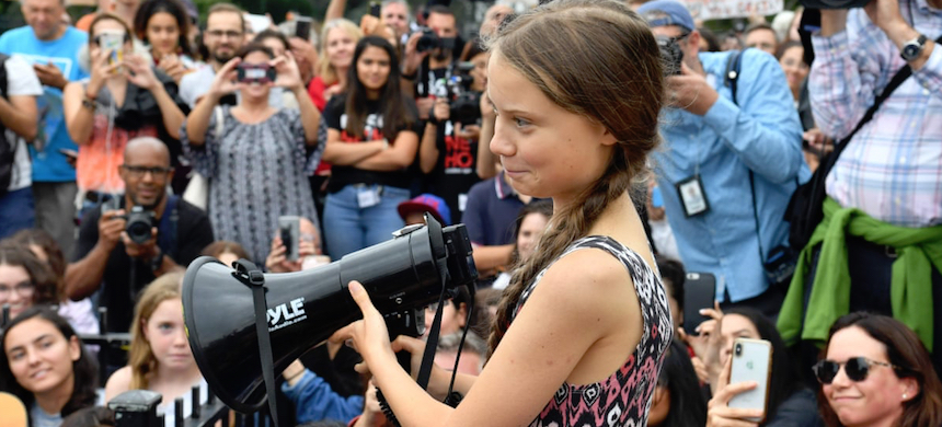 Greta Thunberg speaks at a climate protest outside the White House in Washington, D.C., on September 13. (photo: Nicholas Kamm/AFP/Getty Images)