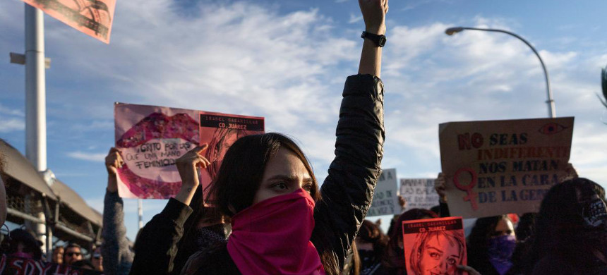 Protesters gather on the Paso del Norte International Bridge in Ciudad Juarez, Mexico, on Saturday to demand justice for artist and activist Isabel Cabanillas, 26, who was killed in the streets of Juarez, Mexico. (photo: Paul Ratje/AFP)