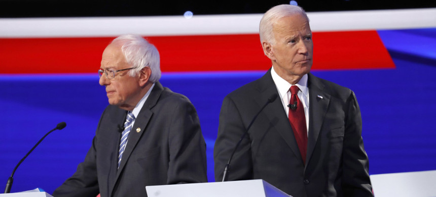 Bernie Sanders and Joe Biden on stage during the Democratic presidential primary debate at Otterbein University, on Oct. 15, 2019, in Westerville, Ohio. (photo: John Minchillo/AP)