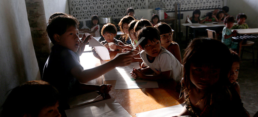 Children gather in a classroom on May 8, 2013, in the village of Kamayura, Brazil. (photo: Ezra Shaw/Getty Images)