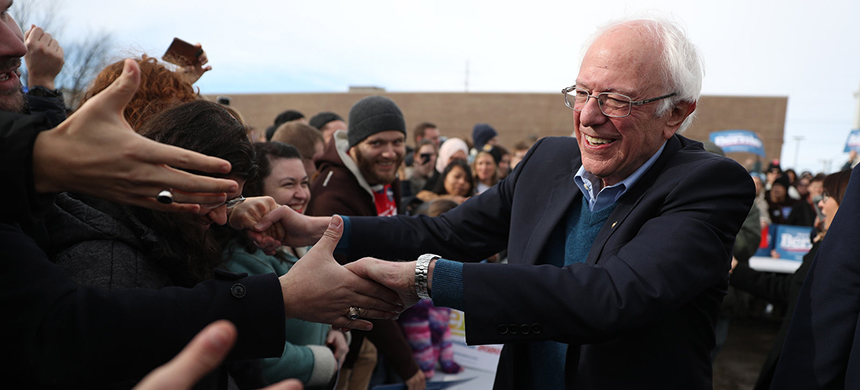 Vermont Sen. Bernie Sanders greets people at a campaign field office in Cedar Rapids, Iowa. Sanders is the slight favorite to win the caucuses, and he hopes it vaults him to the Democratic nomination. (photo: Joe Raedle/Getty Images)