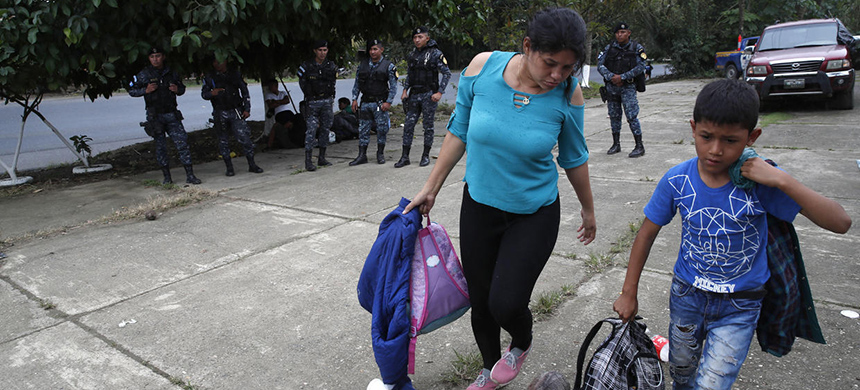 Honduran migrants traveling with a larger group prepare to be deported after being stopped by Guatemalan police in Morales, Guatemala, Thursday, Jan. 16, 2020. (photo: Moises Castillo/AP)