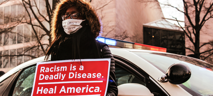 An anti-racism protester in Washington, D.C. (photo: Andrew Stefan/RSN)