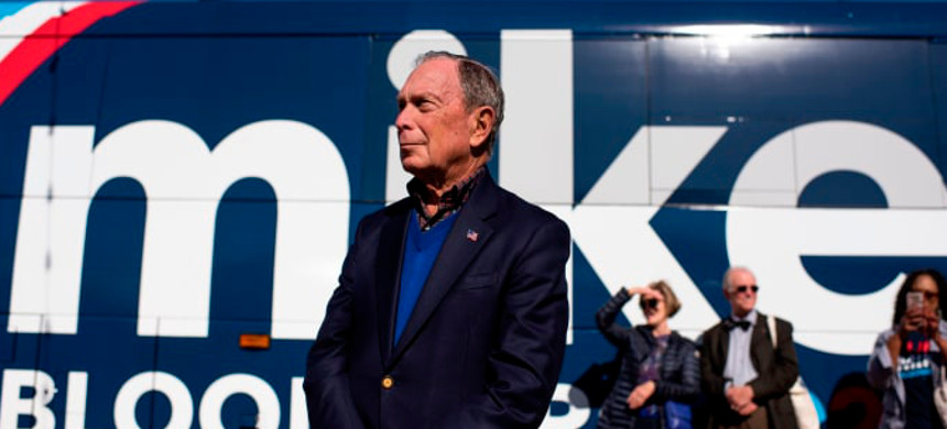 Democratic presidential candidate Mike Bloomberg waits by his tour bus ahead of adressing his supporters at Central Machine Works in Austin, Texas on January 11, 2020. (photo: Mark Felix/Getty)