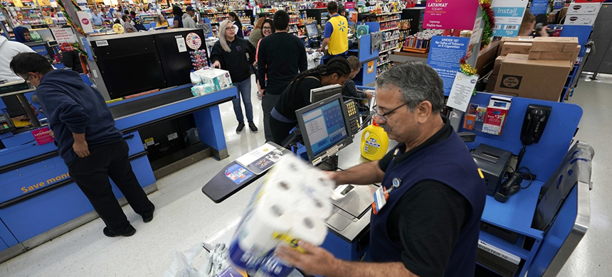 In this Nov. 9, 2018 photo, a Walmart associate checks out customers at a Walmart Supercenter in Houston. (photo: David J. Phillip)