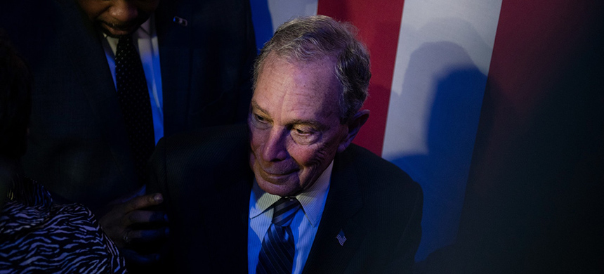 Democratic presidential candidate Mike Bloomberg steps off the stage after a speech in Houston, Texas, on Feb. 13, 2020. (photo: Callaghan O'Hare/Getty Images)