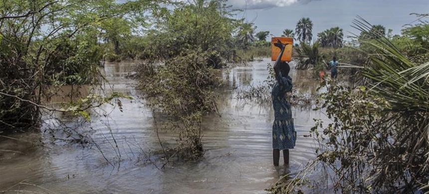A Malawian girl fetches water from a river created by floodwater after Cyclone Idai struck in March 2019. (photo: Amos Gumulira/AFP)