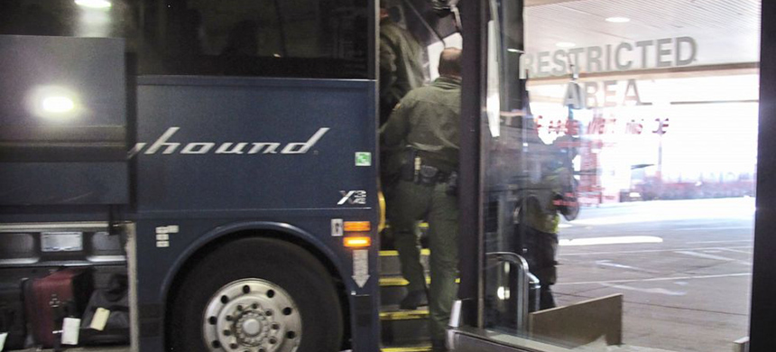 Agents for Customs and Border Protection board a Greyhound bus headed for Portland, Ore., at the Spokane Intermodal Center, a terminal for buses and Amtrak, in Spokane, Washington. (photo: Nicholas K. Geranios/AP)
