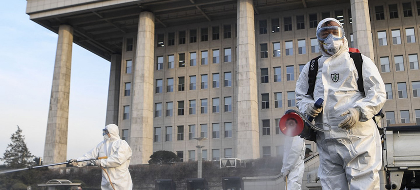 Workers spray disinfectant at the National Assembly in Seoul after it was discovered that a person who took part in a discussion session on 19 February at the Assembly has tested positive for the novel coronavirus. Parliament said that disinfection will be carried out in stages until 26 February. (photo: Yonhap/EPA-EFE/REX/Shutterstock)