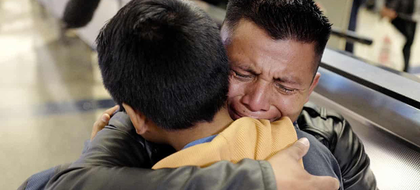 David Xol-Cholom of Guatemala hugs his son Byron at Los Angeles international airport last month as they reunite after being separated about one and half years ago. (photo: Ringo HW Chiu/AP)