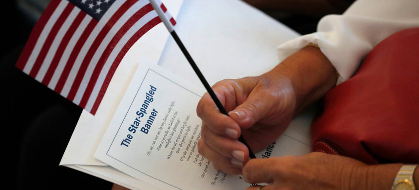 Critics say the Trump administration's emphasis on denaturalizations underscores the idea that naturalized citizens have fewer rights than those born in the United States. (photo: Wilfredo Lee/AP)