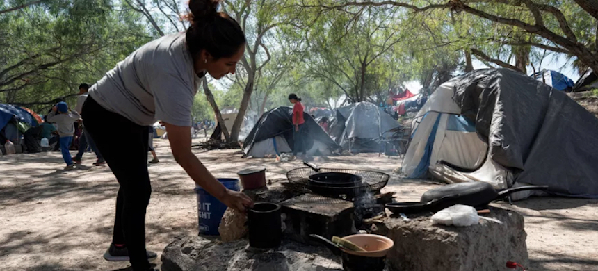 A woman cooks at a camp at Matamoros, Tamaulipas state, Mexico, on November 1, 2019. (photo: Lexie Harrison-Cripps/AFP/Getty Images)