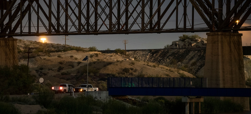 Border Patrol vehicles stand guard near the U.S.-Mexico International Water Boundary late at night on Sept. 12, 2019, in El Paso, Texas. (photo: Paul Ratje/AFP/Getty Images)